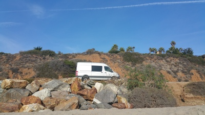 Silver Sprinter van parked along side the PCH freeway